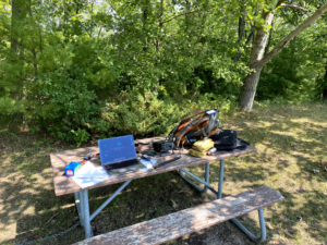 Station setup on the picnic table.